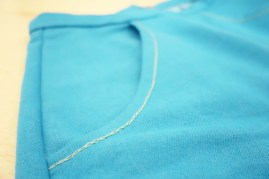 Hand chain-stitching along the front pockets