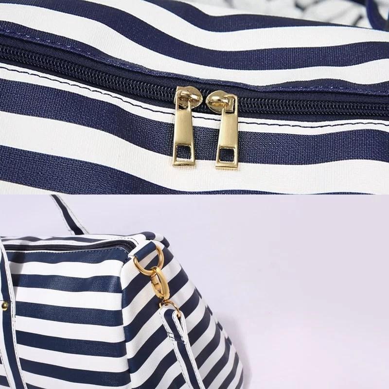 Détails du sac de voyage marinière 48h pour femme en cuir bleu marine.