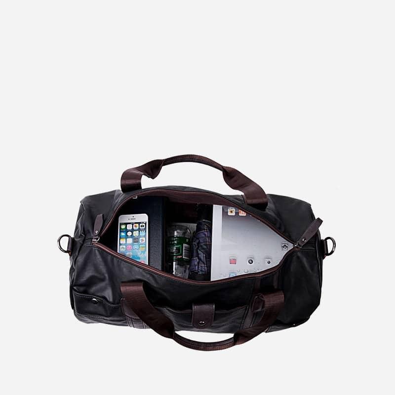Sac à bandoulière et sac à main en cuir noir pour homme avec plusieurs poches zippées et poches intérieures. Magicbag Classic. Intérieur de la sacoche.