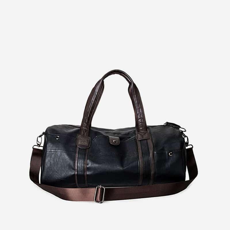 Sac à bandoulière et sac à main en cuir noir pour homme avec plusieurs poches zippées et poches intérieures. Magicbag Classic.