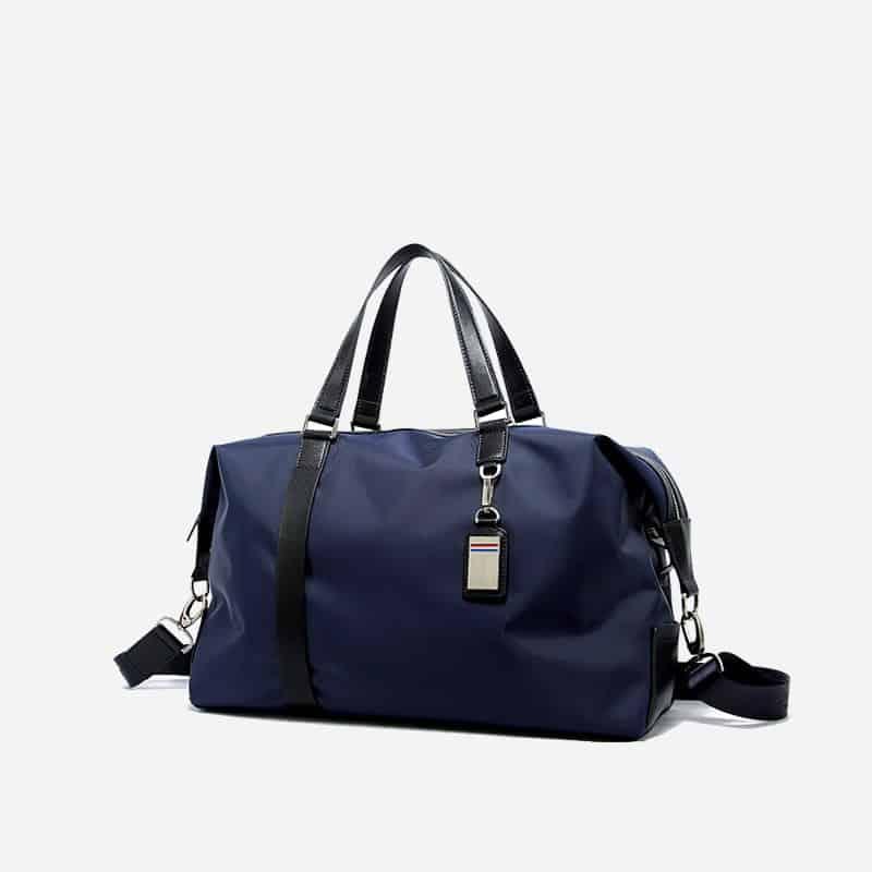 Sac à bandoulière et sacoche bleu pour homme avec plusieurs poches zippées et poches intérieures. Bopaibag Design. Zoom.
