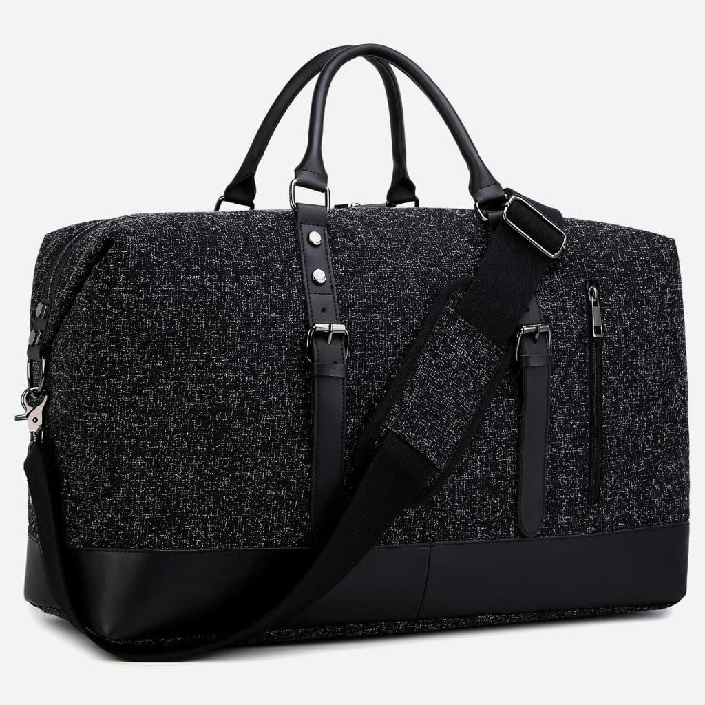 Détails du sac voyage en toile et en cuir noir pour homme et femme.