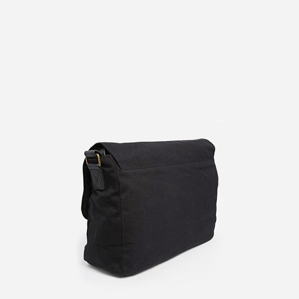 Verso du sac besace homme en tissu noir et cuir noir.