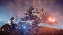 Screen capture of PS4 game Horizon Zero Dawn shows a female character riding a mechanized beast and fighting another mechanized beast.