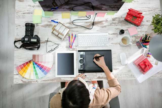 designer working on pen table