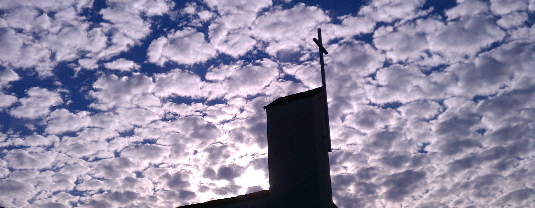 Cross with clouds