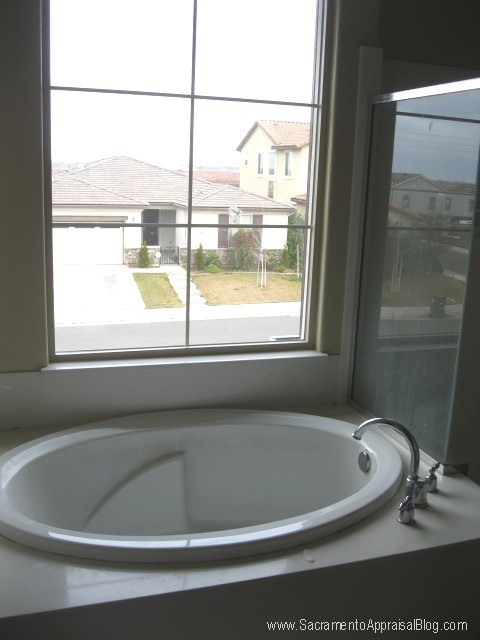Photo of direct view into neighbor's shower by Sacramento Appraiser