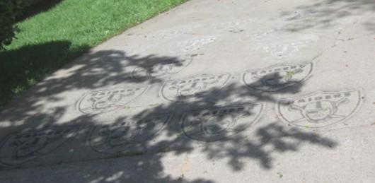 raiders logo painted on driveway