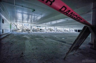 A portion of the underground parking area has an eery feel as construction undergoes outside.
