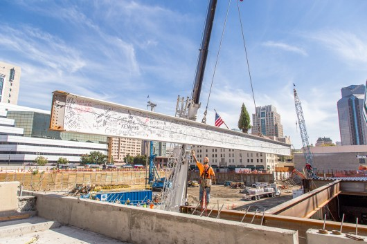 The final beam hangs just before being installed