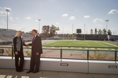 At California State University, Sacramento, Hornet Stadium, John Shirey speaks to long-time friend Kathleen Raske, Athletic Track & Field Director, after the major announcement that the 2014 USA Track & Field National Championships would be returning to Sacramento and be hosted by CSUS. The Championships are a major win for local tourism and economy.