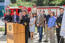 Council and staff gather to announce the end of Fire Company rolling brown outs.