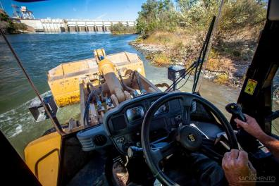 Construction equipment are used to create safe spawning grounds for salmonoid on the American River.