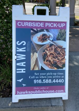 Photo of Hawks at Home Pick-up signage
