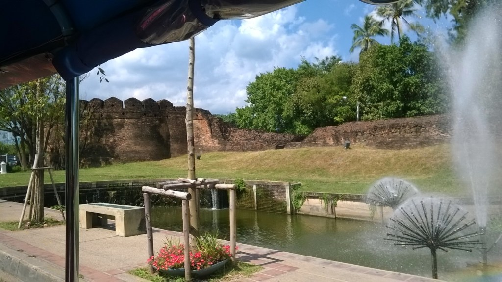 View of the moat and old city wall from our son's first tuk-tuk adventure in Chiang Mai. Sacraparental.com