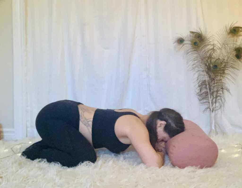 Child's Pose Yoga Pose - Balasana on shaggy carpet