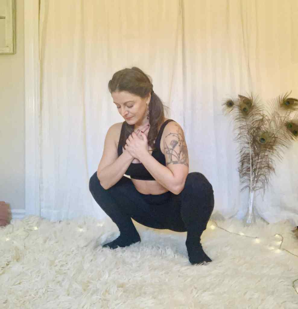 Deep Wide Knee Squat Yoga Pose - Malasana on shaggy carpet