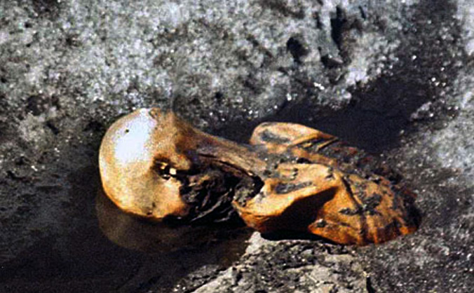Ötzi the Iceman while still frozen in the glacier, photographed by Helmut Simon upon the discovery of the body in September 1991