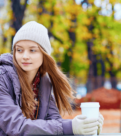 in love (1) young woman holing coffee in hat