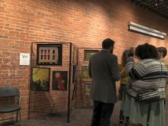 Patrons who had just purchased art are enjoying the party.