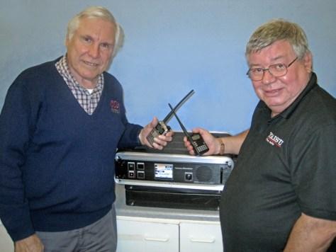 Left, Ken Amos, Chairman, discusses equipment with Paul Bigwood of Yaesu.