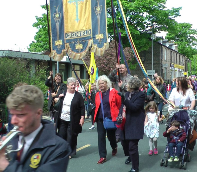 A rare sight as woman Christine Thornton (back left) helps carry the church banner for St Mary's