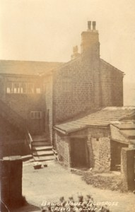 Platt's first workshop on the right at Bridge House, Dobcross c1905