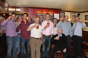 CHEERS: Ray Hicks and members of the Saddleworth Round Table toast the ladies at The Three Crowns