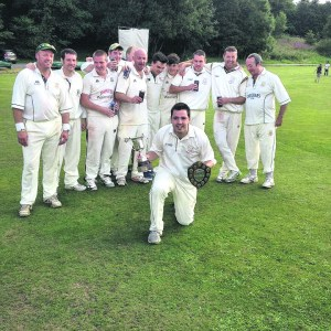 MAN OF THE MATCH: Saddleworth's Steve Taylor with the Moore Cup winning team