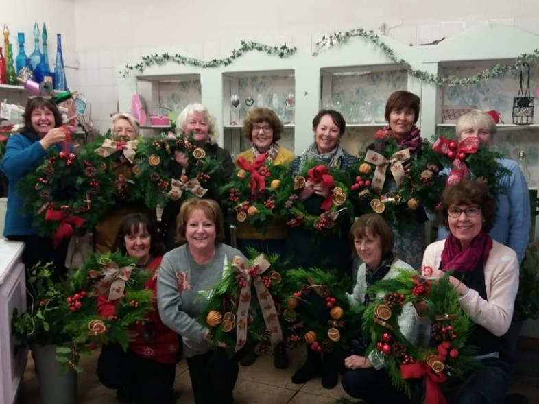 A small group of members taking part in a Wreath Making workshop at The Flower Shop, Uppermill
