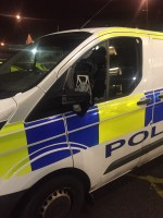 Armed robbers attack police car axe in Oldham