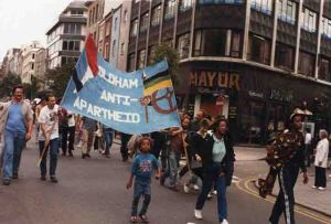 Banner now in Gallery Oldham's collections in use on an anti apartheid march 1986