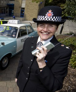 Greater Manchester Police celebrate the 40th anniversary of the opening of Oldham Divisional headquarters. Ch Supt Caroline Ball is pictured with police cars from today and the 1960s. Also pictured are Liz Hibbert and Colin Jackson - both members of staff who were working at the police station on its first day of operation and are still there. Corporate and Media Imaging,  Corporate Communications Branch,  Greater Manchester Police. 0161 856 2777. Picture Desk 0161 856 2279.