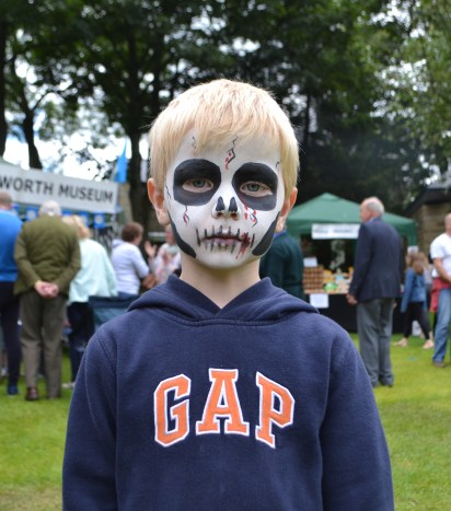 Thomas Evans, 5, shows off his scary face paint