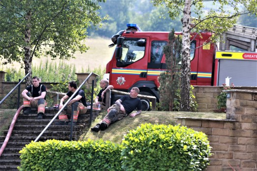 Firemen take a well earned breather (Picture by Carl Royle)