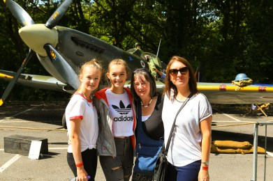 Four ladies enjoy the sun and viewing the Spitfire at Saddleworth School