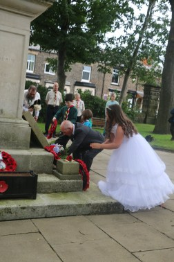 Laying wreaths and flowers at Lees
