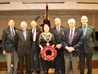 Saddleworth Branch of the Royal British Legion with Chairman Paddy Diamond (centre) and guest of honour Cllr Pam Byrne