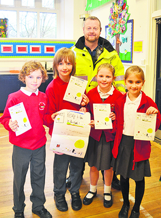 At St Mary's Primary Greenfield, Year 5 pupils Joshua Nixon, Ania Bielecki, Maddie Leadbeater and Sam Howard teamed up to create a poster complete with fierce guard dog.