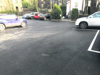 The car park now resurfaced and marked out