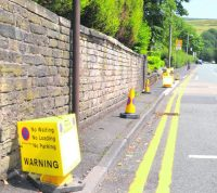 Residents driven round bend by Delph's new double yellow lines