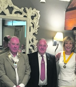 p12 Anthony Burke, left, newly-elected president of Saddleworth Rotary Club with his new vice president, Barbara Howse and outgoing president Stan Bowes, centre2