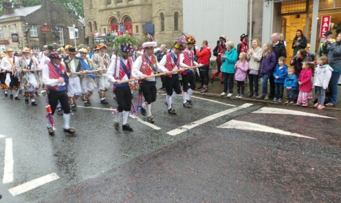 Saddleworth Morris Men lead the rushcart off