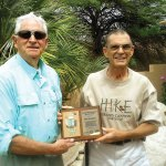 Jim Strickler (right) recently received the Outstanding Volunteer Award from the Arizona Trail Association. It was presented by former SaddleBrooke resident John Rendall, a longtime friend of Jim's and a board member of the AZT.