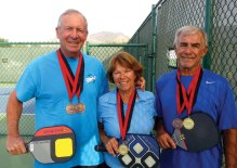 SaddleBrooke resident Bob Shelton (left) and former SaddleBrooke residents, Barbara Gallagher (center) and Larry Gallagher (right), display their medals from the recent pickleball competition at the Huntsman World Senior Games in Utah.