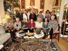 The women of the British Club enjoy a holiday coffee gathering.