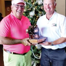 SMGA Special Events Chairman Gus Pachis awards the 2014 Javelina Cup to M-PMGA President Dennis Marchand.