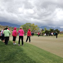 MVLPutters and SaddleBrooke Sputters putting under stormy skies