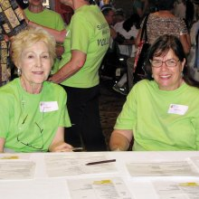 Health Fair volunteers are ready for action in the green tee shirt that is worn proudly by volunteers.