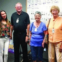 Music Teacher Kaitlyn Miller, SaddleBrooke Singers officers Sam Page, Loretta Tom and Sally Sample